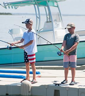Boy fishing off of dock