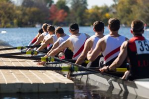 Rowing team pushing off a low profile dock