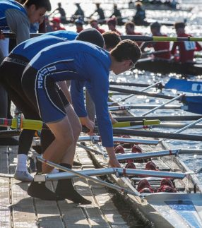 Rowers standing on a low profile dock