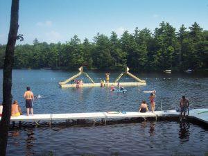 Floating docks with slide at a camp