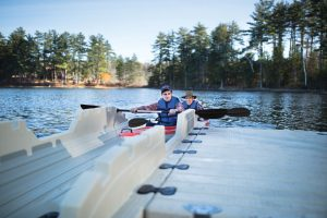 Man and father getting into EZ Launch® Residential Dock