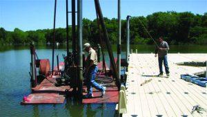 Men on a floating work platform