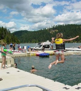 Child jumping off of EZ Trail floating dock