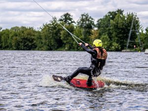 Man wakeboarding in a lake