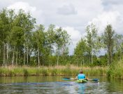 Man canoeing down a river